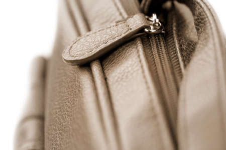 Close up shot of leather bag zipper in sepia color Stock Photo - 9435388