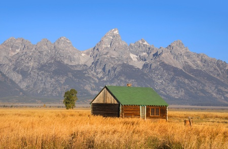 Abandoned house in  Grand Tetons background photo