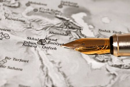 Close up shot of middle east map with pen photo