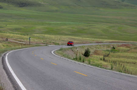 drive through: Scenic drive through prairie landscape in spring time