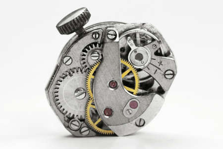 Close up shot of old watch mechanism on white background photo