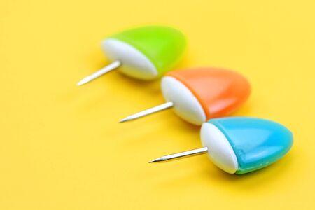 push: Three push pins