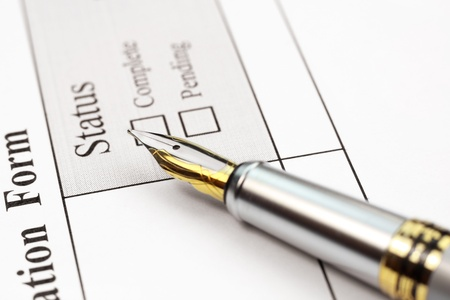 Concept of application form status complete or pending photo