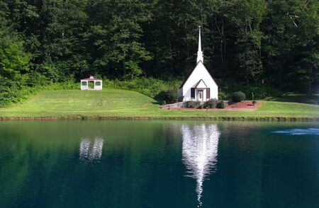 west virginia trees: Scenic landscape with small old church by the lake