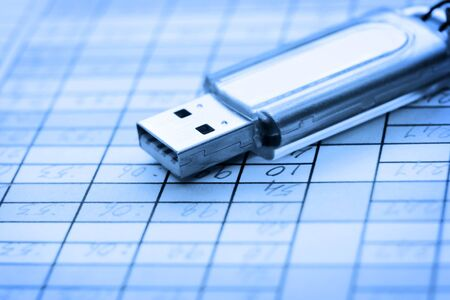 devise: USB devise on a data sheet in blue color tone