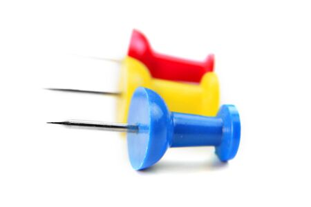 macro shot of blue,red and yellow color push pins photo