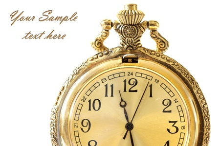 Golden antique watch against white background photo