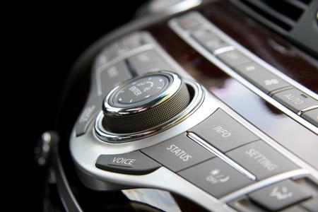 Close up shot of luxury car audio controls 写真素材
