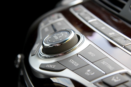 Close up shot of luxury car audio controls photo