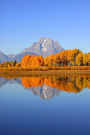 oxbow bend:  Grand Tetons range from Oxbow bend in autumn time Stock Photo