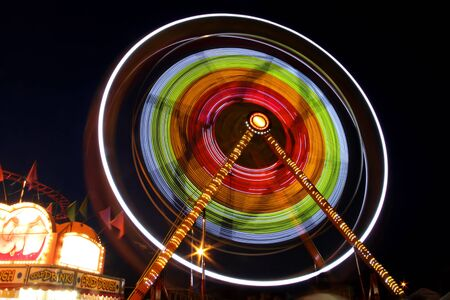 Rotating carnival giant wheel in night time  photo