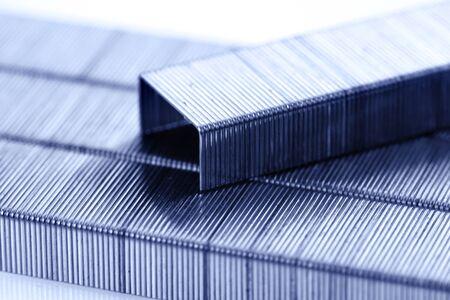 staples: bar of staples arranged on staples background