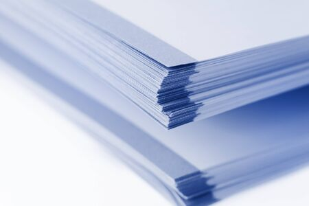 Stack of big book papers on white background photo