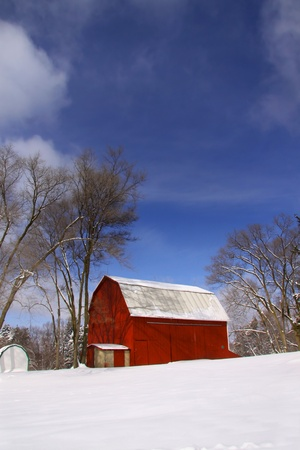 Old  barn in the snow during winter time  photo