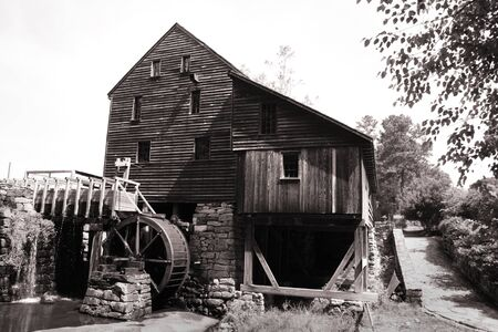 Historic Yates grist mill in black and white photo