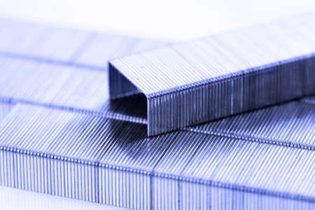 office stapler: bar of staples  on staple bar background