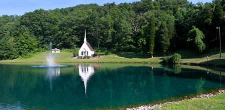 west virginia trees: Panoramic view of historic church and pond in front of in West Virginia