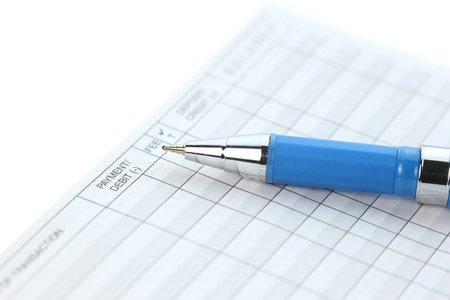 bank records: Check balance table booklet and blue pen Stock Photo