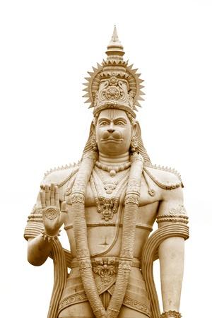 Hindu god Hanuman statue against white background photo