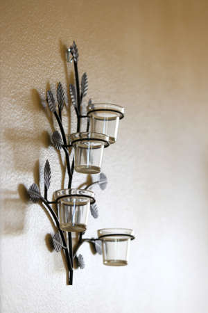 candle holders: Four candle holder on the wall