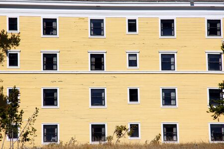 Windows on old yellow building walls photo
