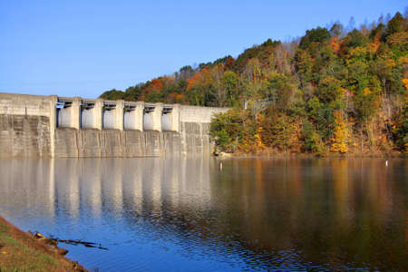 west virginia trees: Sutton reservoir and dam in autumn time Stock Photo