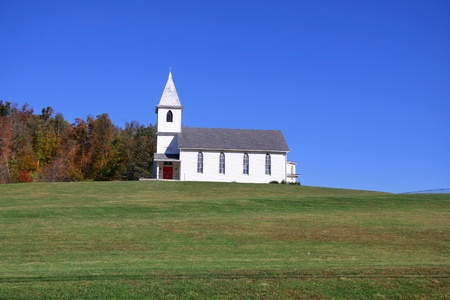 Small church on top of a green hill in West Virginia