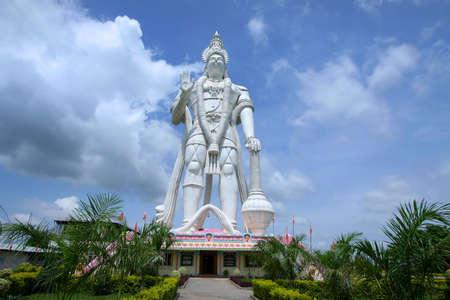 hanuman: Huge mighty Hanuman statue against cloudy skies in India