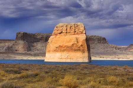 Lone rock monument in Lake powell photo