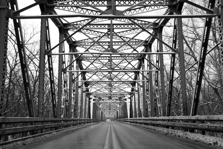 black and white: Road through metal bridge tunnel  Stock Photo