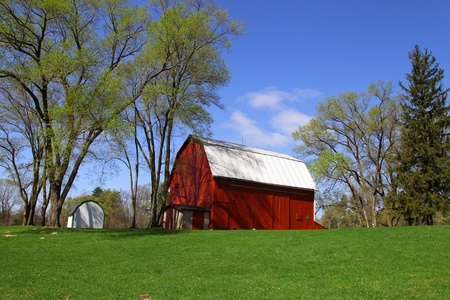Old red barn and spring trees photo