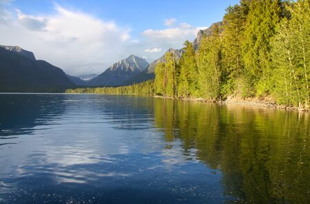 donald: Morning reflections in Lake Mc Donald in Glacier national park