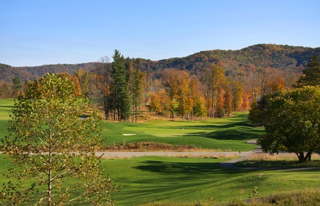 Beautiful golf course in the middle of hills photo