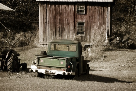 Old truck in front of a old barn photo