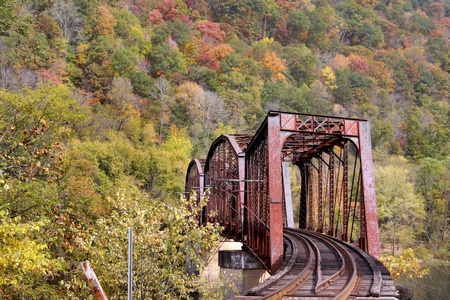 diesel train: Rural train track in west Virginia mountains in autumn time Stock Photo