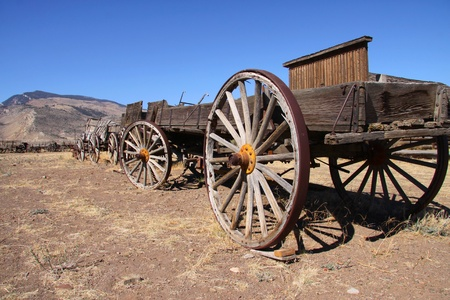 western town: Old carts near Cody Wyoming in a Ghost town Stock Photo