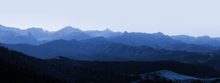 Panoramic view of Rocky mountains in evening time photo
