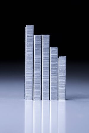 Staple strips arranged in the form of graph  Stock Photo - 13619154
