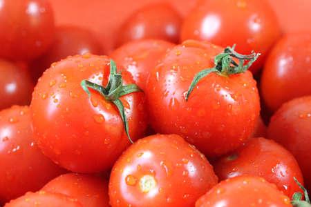 Many fresh ripe tomatoes close up shot