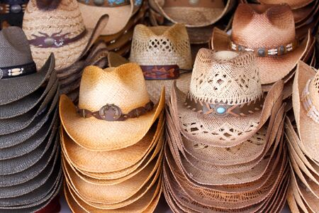 Set of straw made cowboy hats stacked together  photo