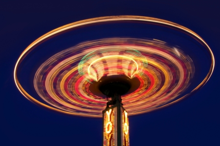Carnival yoyo wheel in the motion in night time photo