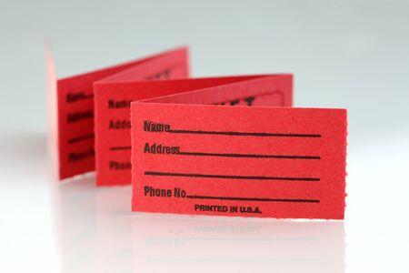 Red raffle ticket strip on white background photo