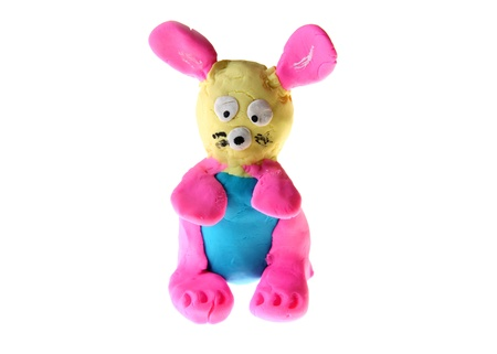 clay modeling: Pink bunny hand made with play dough Stock Photo