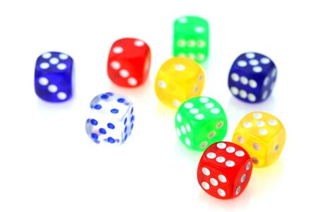 double the chances: Different colorful glassy dies on white background