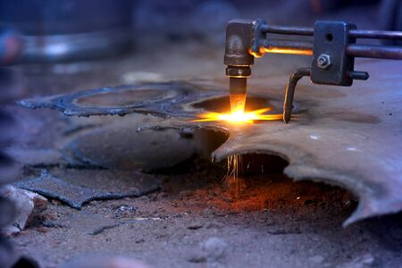 Close up shot of gas cutting torch photo