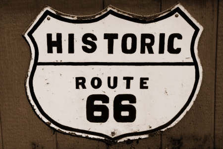 Old historic route 66 sign in sepia photo