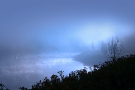 windless: Misty morning with sun raise over lake Stock Photo
