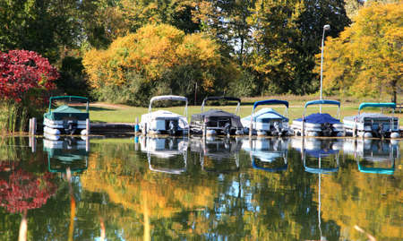 Small bots in the dock with autumn reflection