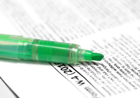 taxation: Green marker on W4 form