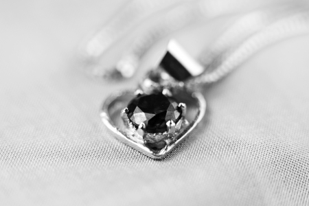 Close up shot of heart shaped pendant photo